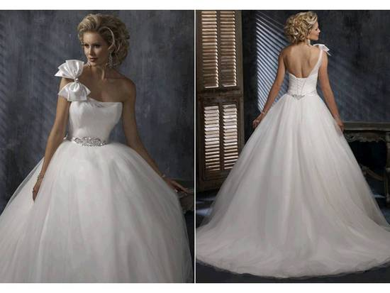 White one-shoulder ballgown wedding dress with corset bodice