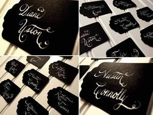 photo of Black and ivory calligraphied escort cards