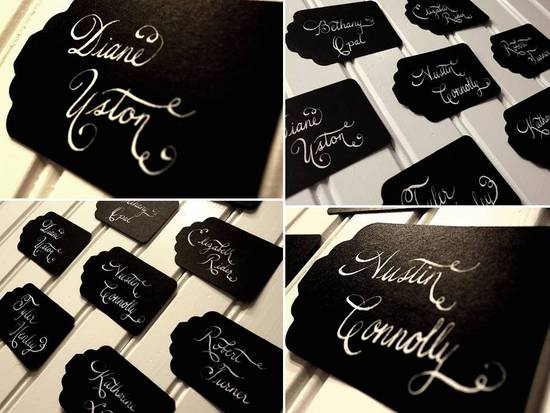 Luxe and sophisticated black escort cards with ivory custom calligraphy