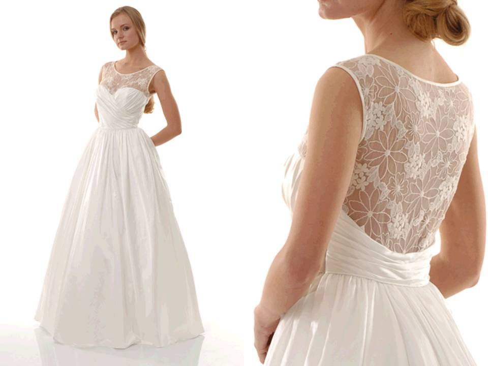Empire waist ballgown wedding dress with sweetheart neckline and lace overlay
