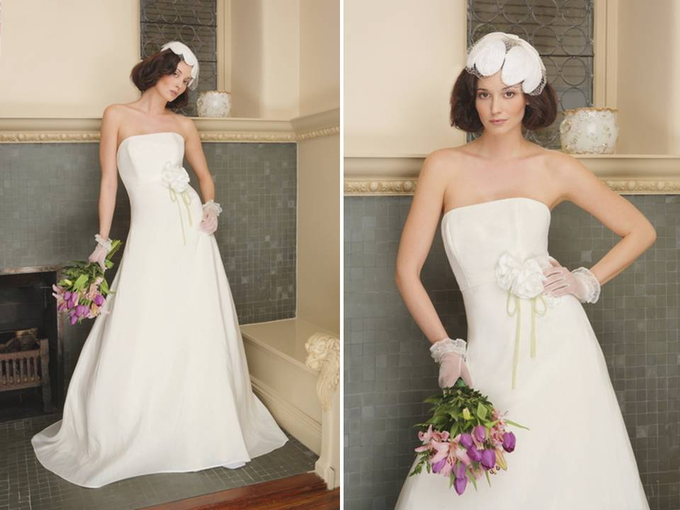 Natural-bridals-classic-strapless-a-line-ivory-eco-friendly-green-bridal-gowns-floral-applique-bridal-sash.full