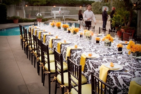 Outdoor wedding by the pool with unique long wedding reception tables