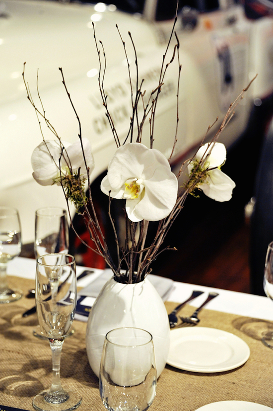 Simple white centerpieces for farm style reception tables
