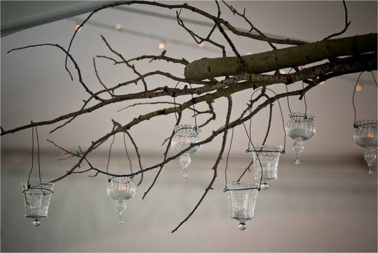 Textured wedding reception decor- manzanita branches hung with tea lights