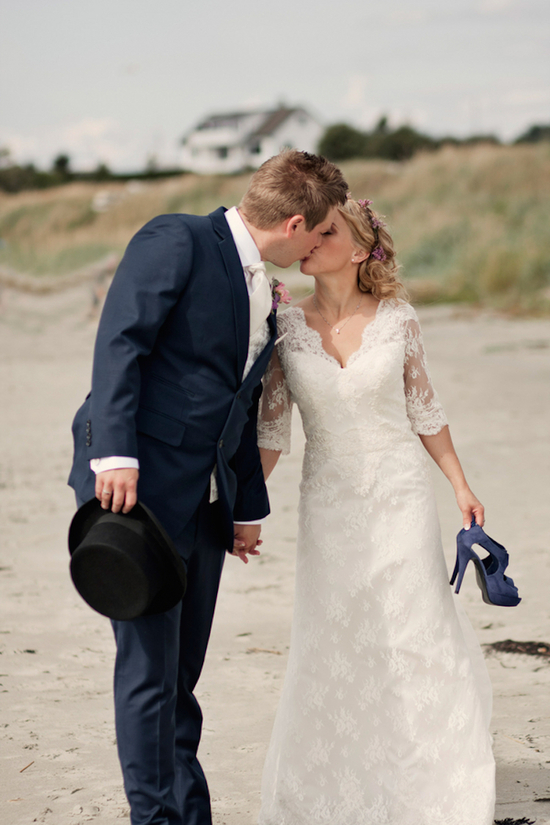 Real wedding kiss on the beach