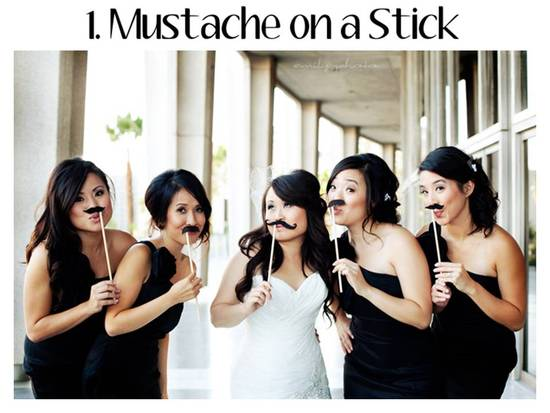 Mustache on a Stick for wedding reception fun- one trend that's no longer IN for 2011