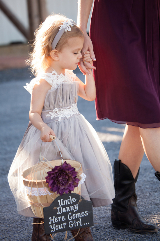 Adorable flower girl at a rustic barn wedding
