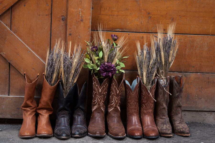 Cow boy boots with bouquets for a country wedding
