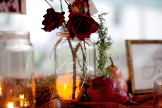 Rustic autumn wedding reception decor- single red rose in mason jar and lots of romantic candles