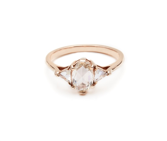 Rose gold engagement ring with three diamonds