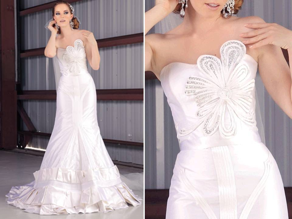 White a-line strapless wedding dress with beading and pleating details on bodice