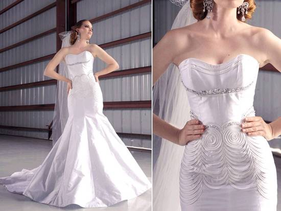 Stunning white strapless drop waist mermaid wedding dress by Jorge Manuel