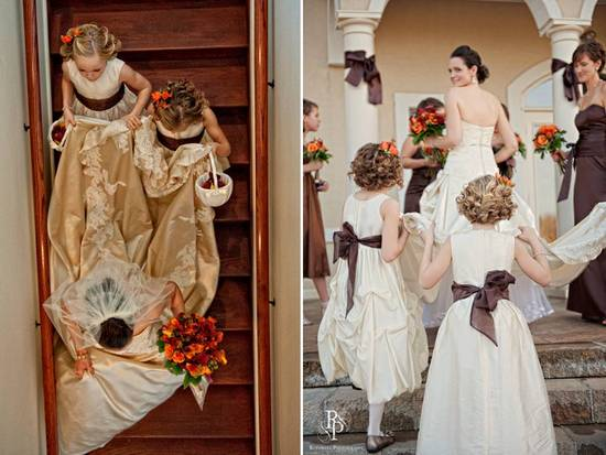 Flower girls in ivory dresses with chocolate brown sashes help bride with her wedding dress