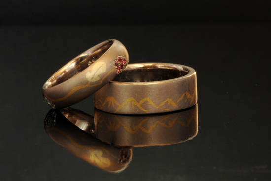 Inlaid mountain and vineyard wedding bands