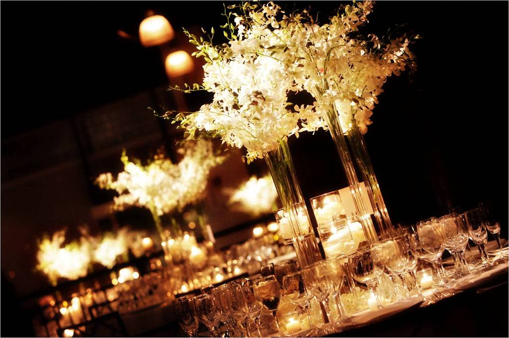 Beautiful wedding reception floral centerpieces with romantic candlelight