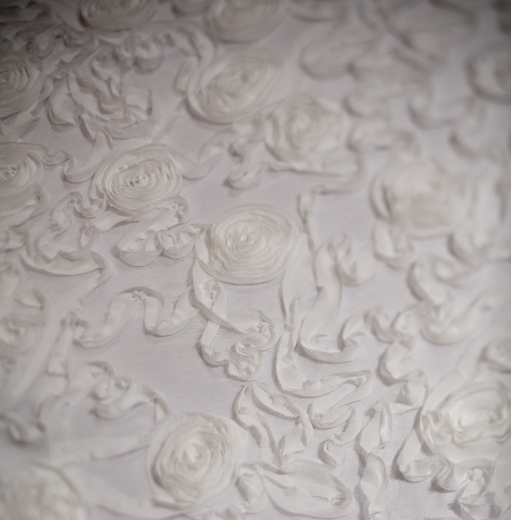 Textured table linens, like pin tuck taffeta, in diamond white are ...