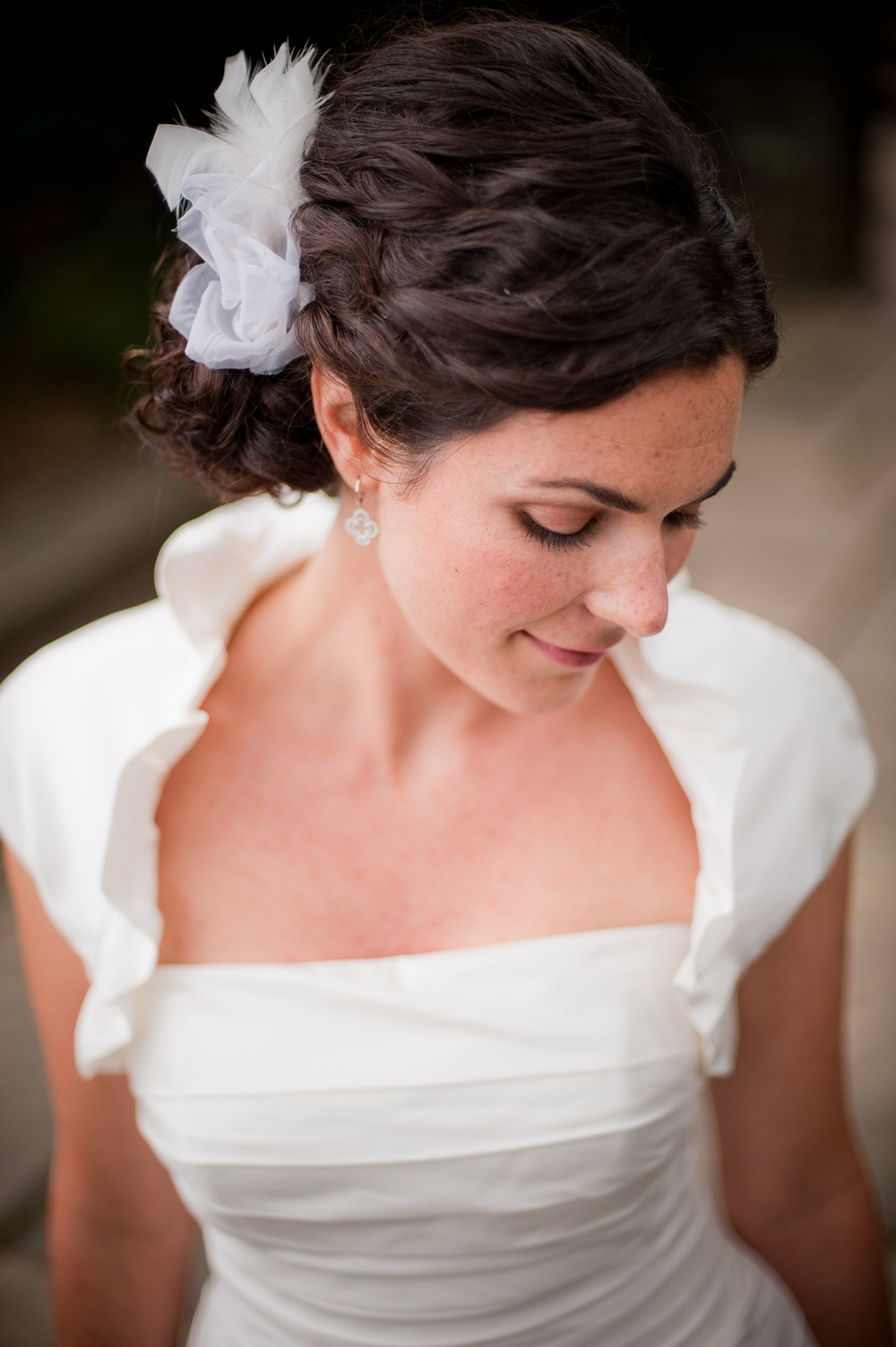 Romantic low bridal updo for thick, curly hair
