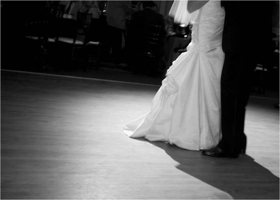 Artistic black and white wedding photo- bride and groom share first dance