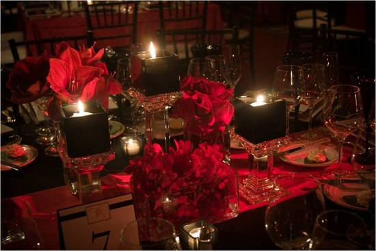 photo of Crimson red wedding color palette with lots of candlelight on reception tables