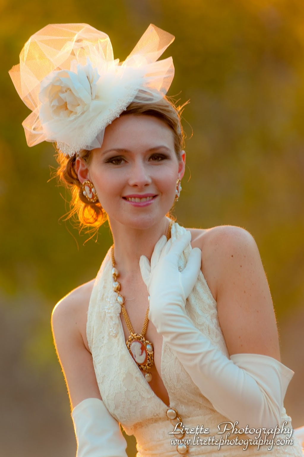 Vintage-inspired bridal look- cameo necklace, couture bridal headpiece