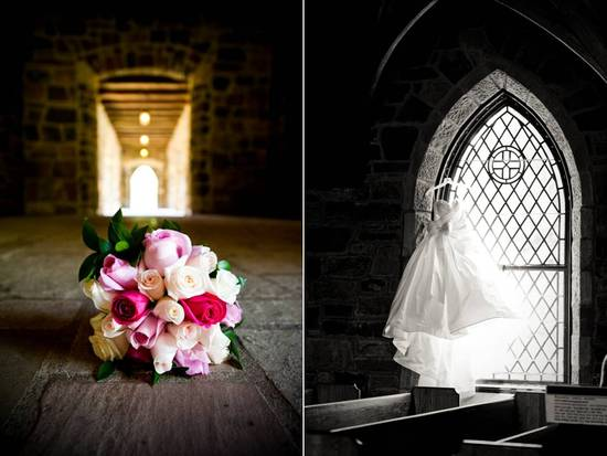 Ivory, pink bridal bouquet lays on venue floor; wedding dress hangs in window