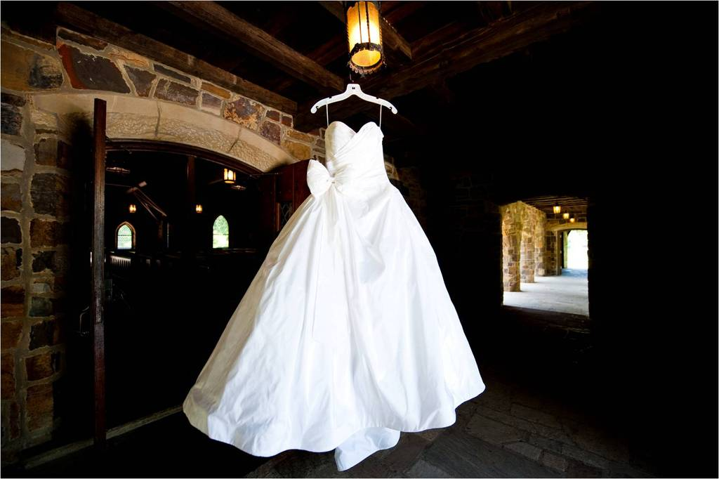 White-ballgown-strapless-wedding-dress-hangs-in-venue-castle.full