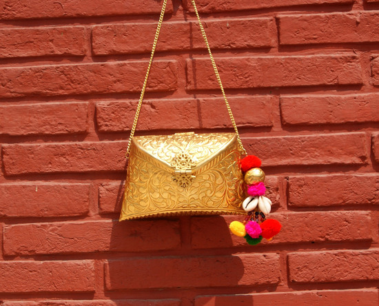 Engraved Gold Clutch Bag With Kutchh Work Tassel