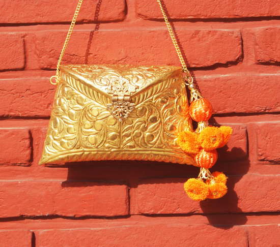 Engraved Gold Clutch Bag With Drops Of Orange Tassel