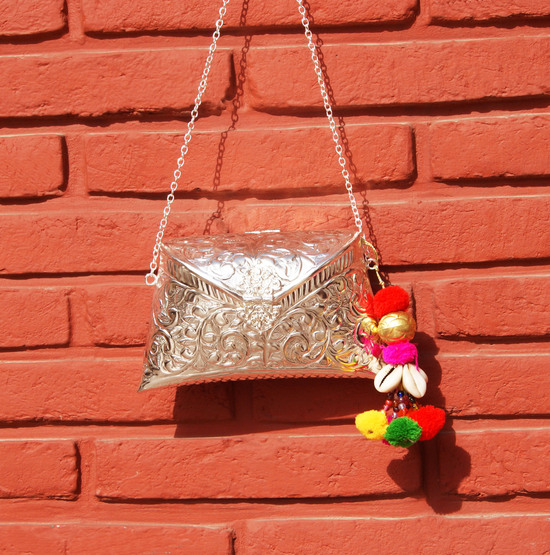 Engraved Silver Clutch Bag With Kutchh Work Detail Tassel