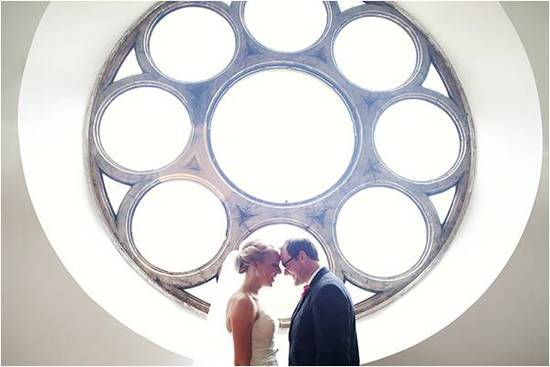 Bride and groom take couple's photos at gorgeous ceremony venue