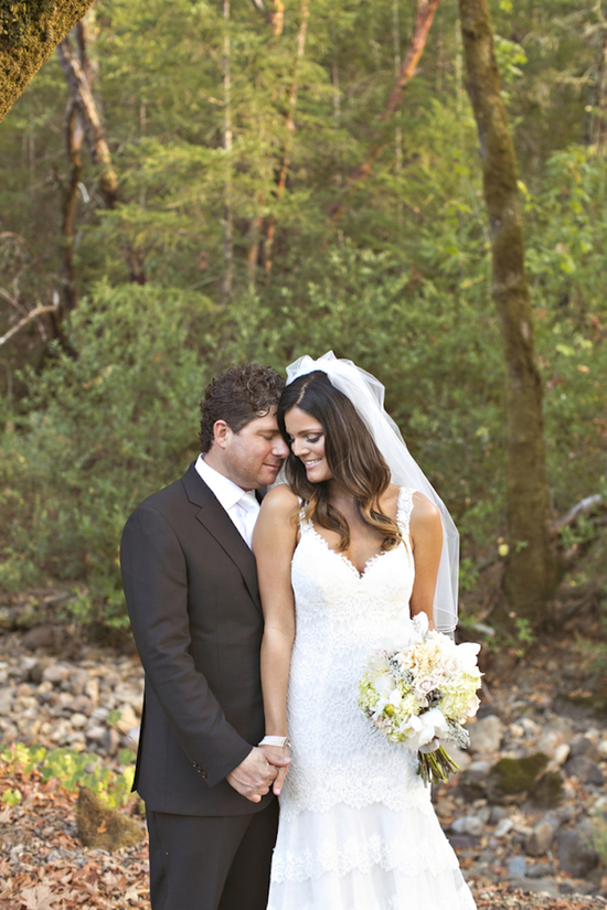 Bride and groom pose in the woods