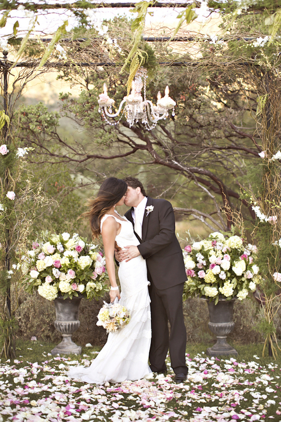 Ceremony kiss at a glamorous altar