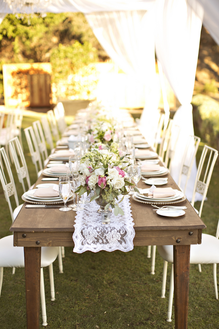 Outdoor reception table with lace runner