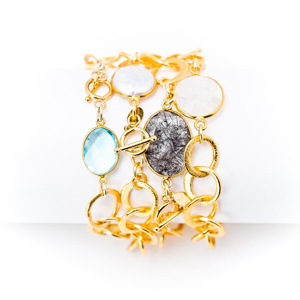 Gem_and_gold_link_bracelets.full