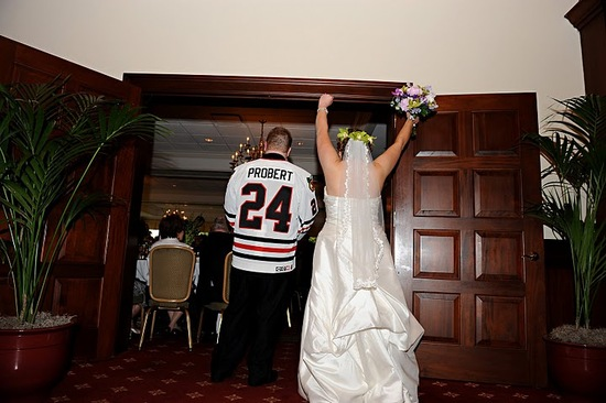 hockey-themed bride and groom wedding reception introduction