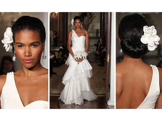 White one-shoulder 2011 Carolina Herrera wedding dress and white flower hair accessory