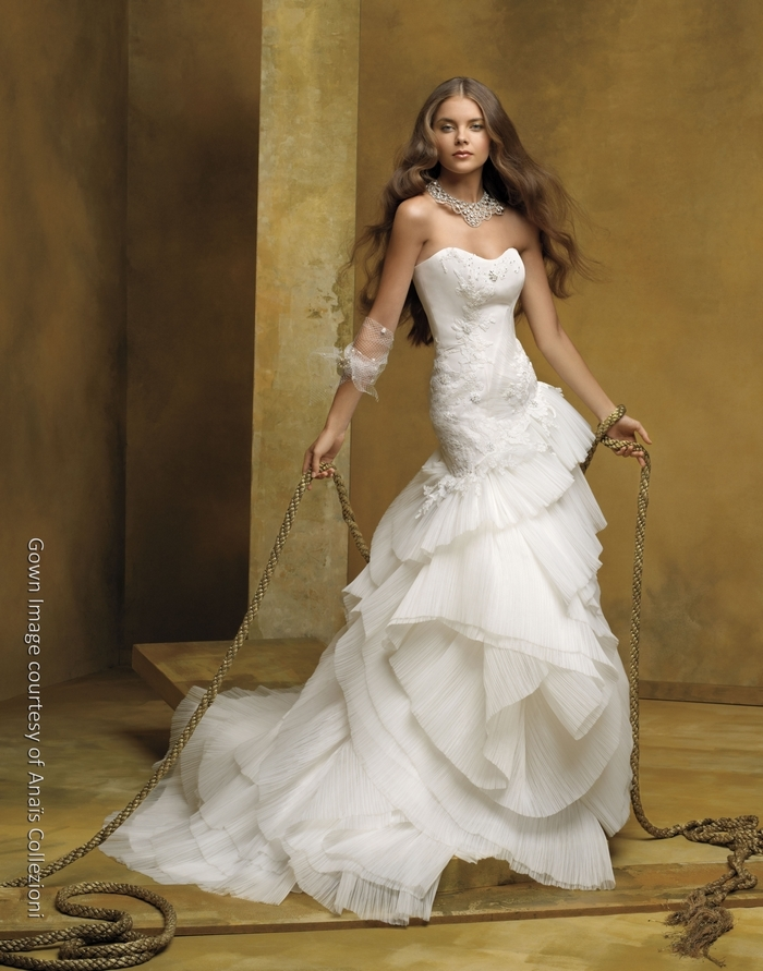 Ivory 2011 wedding dress with strapless neckline and asymmetrical skirt