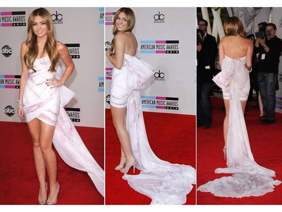 Miley Cyrus in white Marchesa mini dress with long train