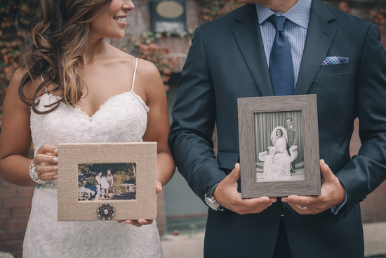 Couple holds pictures of their parents weddings