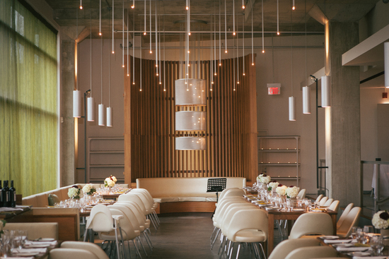 Urban indoor ceremony and reception setting