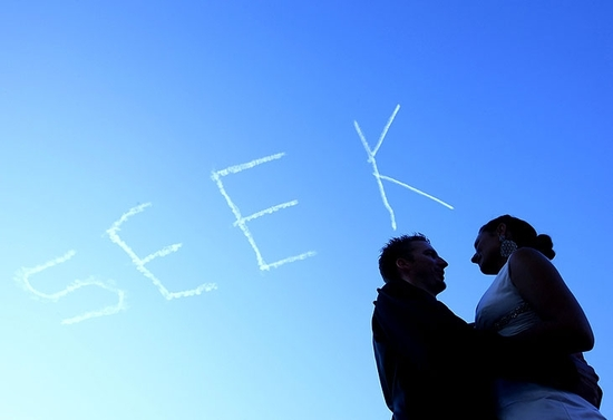 "Artistic wedding photo with ""Seek"" spelled out in the sky"