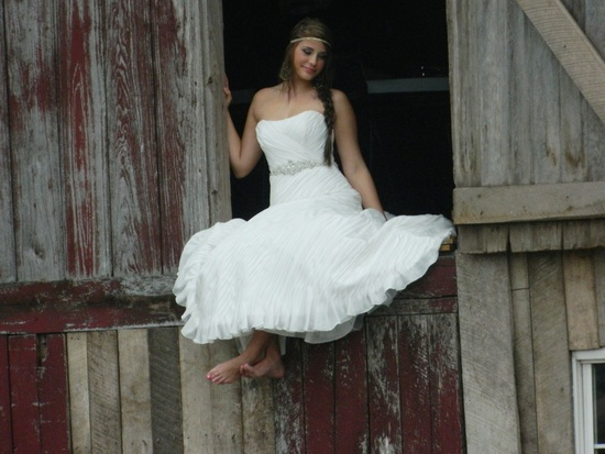 Girl in loft of Wedding Barn models a dress from Norma's Inline Fashions