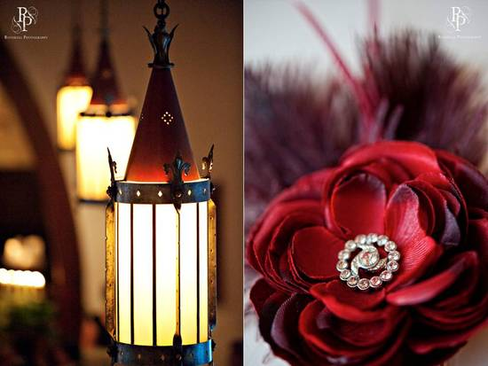 Deep red roses with feathers and romantic lanterns for chic wedding reception decor