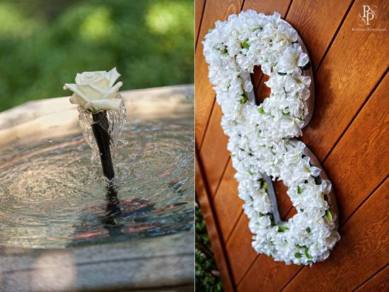 Ivory flowers clustered to make a monogram B for wedding ceremony