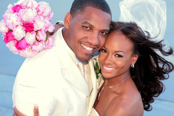 Bride-and-groom-pose-with-wind-blowing-white-pink-wedding-color-palette.original