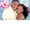 Bride-and-groom-pose-with-wind-blowing-white-pink-wedding-color-palette.square