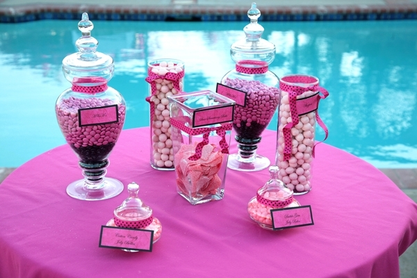 Delicious hot pink candy bar at outdoor California wedding reception