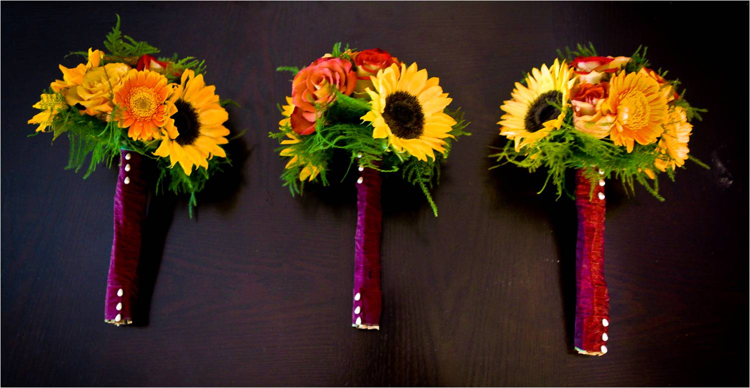 Rich fall wedding bridesmaids bouquets with sunflowers and roses wrappe