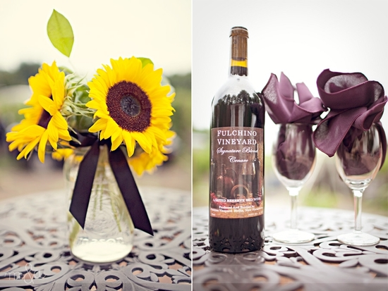 Vibrant sunflower wedding reception centerpieces, and wine from the vineyard