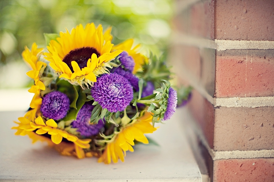 Vibrant bridesmaid bouquet made from sunflowers and purple fresh flowers mightylinksfo